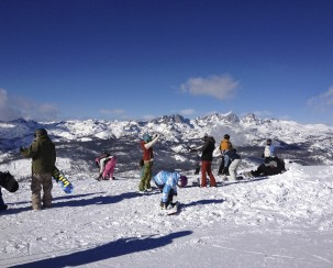 Summit meeting. Snowboarders and skiers admire the view of the Sierra Nevada Mountains from 11,000 feet high.