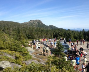 Racers coming through the finish line. The true top of Vermont off in the distance.