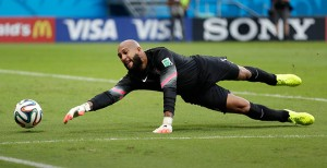 By going to ground so well, Tim Howard ensured that the USA left with its head held high. Photograph: Julio Cortez/AP